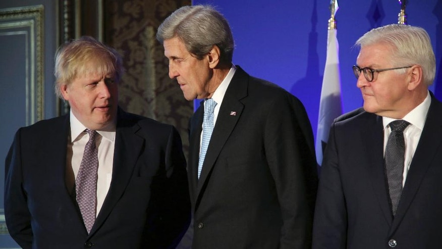 U.S. Secretary of State John Kerry, center, British Foreign Secretary Boris Johnson, left, and German Foreign Minister Frank-Walter Steinmeier, talk during a family picture prior to a meeting, in Paris, Saturday, Dec. 10, 2016. Kerry and leading diplomats are trying to find solutions for Syria's desperate opposition, as Syrian government forces squeeze rebels out of Aleppo after a devastating blitz. (AP Photo/Thibault Camus, Pool)