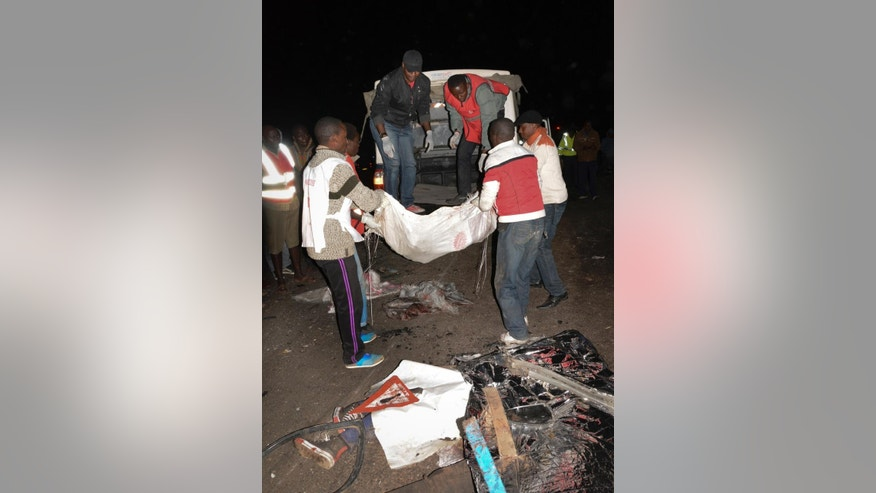 Rescuers remove bodies from the scene of an accident near Naivasha, Kenya Sunday, Dec. 11, 2017. A tanker carrying chemical gas slammed into other vehicles and burst into flames on a major road in Kenya, officials said Sunday. (AP Photo)