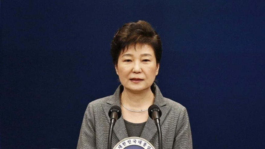 FILE - In this Tuesday, Nov. 29, 2016, South Korean President Park Geun-hye makes a live televised address in Seoul, South Korea. North Korea's state-run media, relentless critics of South Korean leader Park, got off to a slow start in telling their nation of her actual impeachment. (Pool Photo via AP)