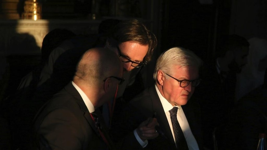 German Foreign Minister Frank-Walter Steinmeier, right, attends a meeting on Syria, in Paris, Saturday, Dec. 10, 2016.  Leading diplomats from US, Europe, middle east and Syria's opposition are meeting in Paris. (AP Photo/Thibault Camus, Pool)