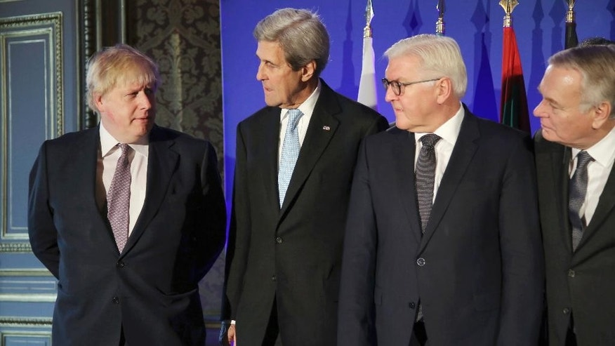 From left; British Foreign Secretary Boris Johnson, U.S. Secretary of State John Kerry, German Foreign Minister Frank-Walter Steinmeier, and French Foreign Minister Jean Marc Ayrault talk during a family picture prior to a meeting in Paris, Saturday, Dec. 10, 2016. Kerry and leading diplomats are trying to find solutions for Syria's desperate opposition as Syrian government forces squeeze rebels out of Aleppo after a devastating blitz. (AP Photo/Thibault Camus, Pool)