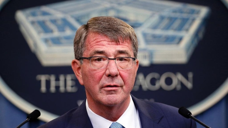 FILE - In this June 30, 2016, file photo, Defense Secretary Ash Carter speaks during a news conference at the Pentagon. Carter on Friday, Dec. 9, made an unannounced visit to Afghanistan to consult with military commanders and deliver a pre-holiday pep talk to U.S. troops. (AP Photo/Alex Brandon, File)