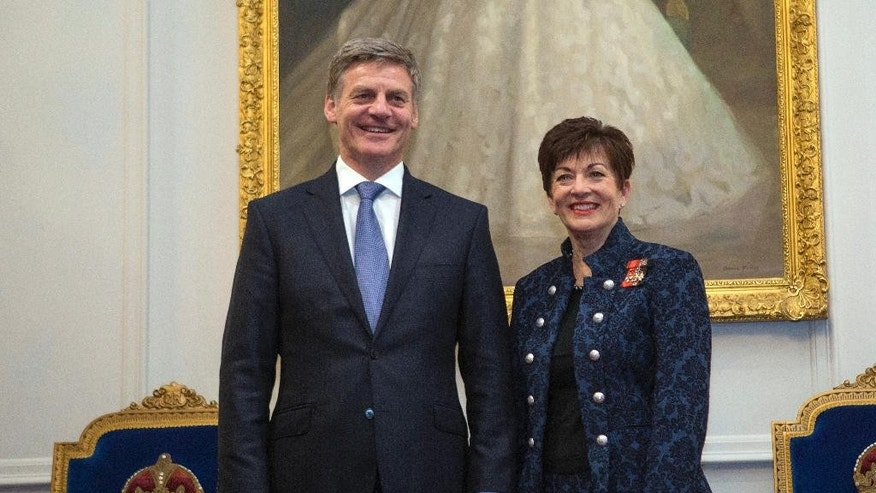 New Zealand Prime Minister Bill English, left, stands with the Governor-General, Dame Patsy Reddy, after being sworn-in at Government House in Wellington, New Zealand, Monday, Dec. 12, 2016. English, former New Zealand's finance minister and a former farmer, was sworn in as the country's 39th prime minister on Monday after his colleagues in the Parliament chose him as their new leader. (Mark Mitchell/New Zealand Herald via AP)
