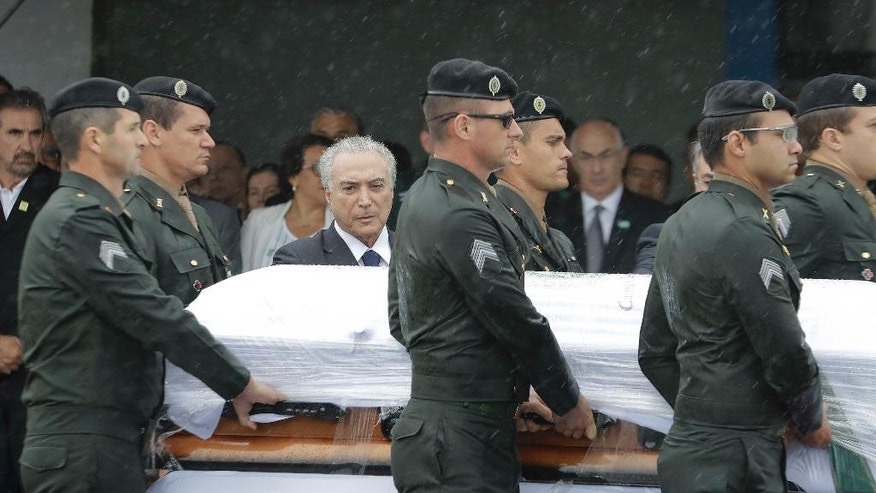FILE - In this Dec. 3, 2016, file photo, President Michel Temer attends the arrival ceremony of the coffins with the remains of Chapecoense soccer team victims, in Chapeco, Brazil. As Brazilians mourned the recent plane crash, President Michel Temer spent days publicly wavering about whether to attend the memorial service. (AP Photo/Andre Penner, File)