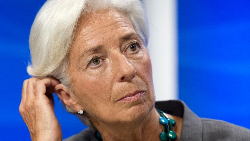 FILE - In this  June 22, 2016 file photo, International Monetary Fund Managing Director Christine Lagarde speaks during a news conference in Washington. Lagarde is facing a negligence trial in France which opens on Monday, Dec. 12, 2016, for her role in a 2008 arbitration ruling that handed 403 million euros ($425 million) to a French business magnate. (AP Photo/Cliff Owen, File)