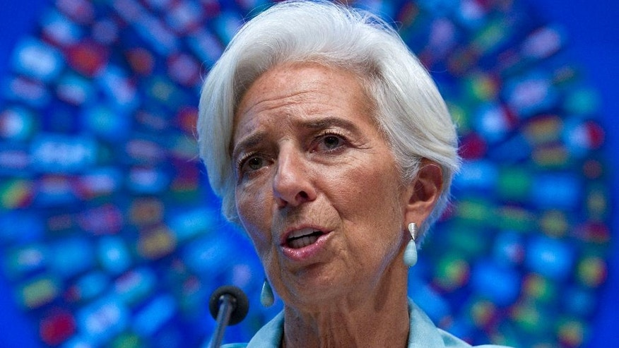 FILE - In this Oct. 8, 2016 file photo, International Monetary Fund (IMF) Managing Director Christine Lagarde speaks during a news conference in Washington. Christine Lagarde is taking time off her day job solving the world's financial crises to face trial Monday, accused of looking the other way while the French state handed $425 million to a tycoon close to the president. (AP Photo/Jose Luis Magana, File)