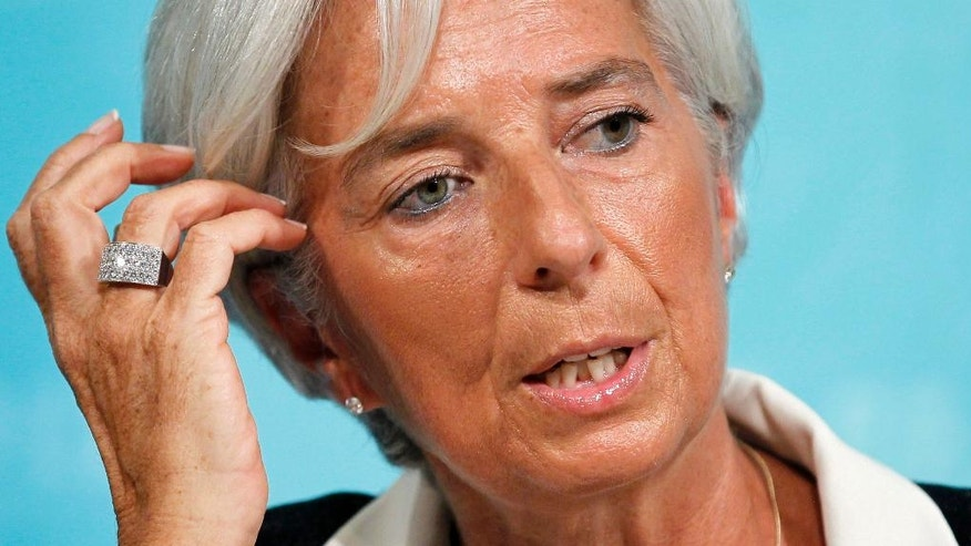 FILE - In this Tuesday, July 3, 2012 file picture, International Monetary Fund Managing Director Christine Lagarde speaks during a news conference in Washington. Christine Lagarde is taking time off her day job solving the world's financial crises to face trial Monday, accused of looking the other way while the French state handed $425 million to a tycoon close to the president. (AP Photo/Haraz N. Ghanbari, File)