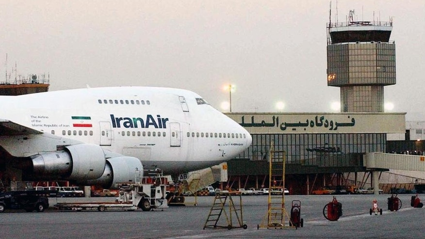 FILE - In this June 2003 file photo, a Boeing 747 of Iran's national airline is seen at Mehrabad International Airport in Tehran. Iran said Sunday it has finalized a $16.8 billion deal with Boeing to purchase 80 passenger planes, a deal made possible by last year's landmark nuclear agreement. (AP Photo/Hasan Sarbakhshian, File)