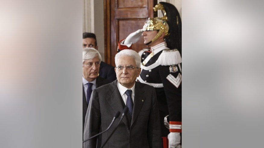 Italian President Sergio Mattarella arrives to meet reporters at the Quirinale Palace in Rome, Saturday, Dec. 10, 2016. With a banking crisis adding urgency, Italy's president was wrapping up political consultations Saturday, including with Parliament's largest party, the Democrats, before picking a replacement for caretaker Premier Matteo Renzi. (Giuseppe Lami/ANSA via AP)