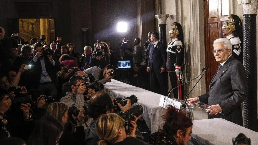 Italian President Sergio Mattarella meets the media at the Quirinale Palace in Rome, Saturday, Dec. 10, 2016. With a banking crisis adding urgency, Italy's president was wrapping up political consultations Saturday, including with Parliament's largest party, the Democrats, before picking a replacement for caretaker Premier Matteo Renzi. (Giuseppe Lami/ANSA via AP)