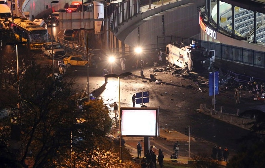 Rescue services work at the scene of explosions near the Besiktas football club stadium after attacks in Istanbul, late Saturday, Dec. 10, 2016. Two explosions struck Saturday night outside a major soccer stadium in Istanbul after fans had gone home, an attack that wounded about 20 police officers, Turkish authorities said. Turkish authorities have banned distribution of images relating to the Istanbul explosions within Turkey.(DHA via AP)
