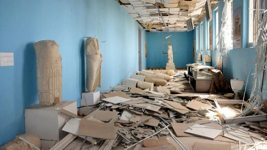 FILE - This file photo released March 27, 2016, by the Syrian official news agency SANA, shows destroyed statues at the damaged Palmyra Museum, in the city of Palmyra, central Syria. Palmyra, the archaeological gem that Islamic State fighters retook Sunday, Dec. 11, 2016, from Syrian troops, is a desert oasis surrounded by palm trees, and a UNESCO world heritage site, that boasts 2,000-year-old towering Roman-era colonnades and priceless artifacts. It is also a strategic crossroads linking the Syrian capital, Damascus, with the country's east and neighboring Iraq. (SANA via AP, file)