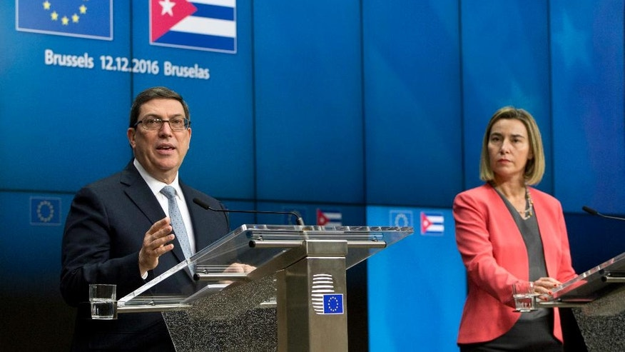 European Union High Representative Federica Mogherini, right, and Cuba's Foreign Minister Bruno Rodriguez participate in a media conference at the EU Council building in Brussels on Monday, Dec. 12, 2016. The European Union and Cuba have signed their first ever agreement on closer ties with the aim of supporting economic development and promoting democracy and human rights on the island. (AP Photo/Virginia Mayo)