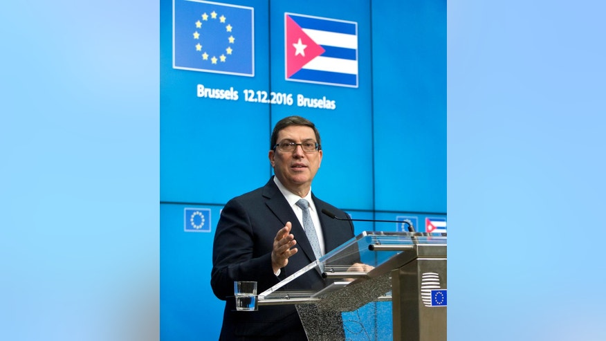 Cuba's Foreign Minister Bruno Rodriguez speaks during a media conference at the EU Council building in Brussels on Monday, Dec. 12, 2016. The European Union and Cuba have signed their first ever agreement on closer ties with the aim of supporting economic development and promoting democracy and human rights on the island. (AP Photo/Virginia Mayo)