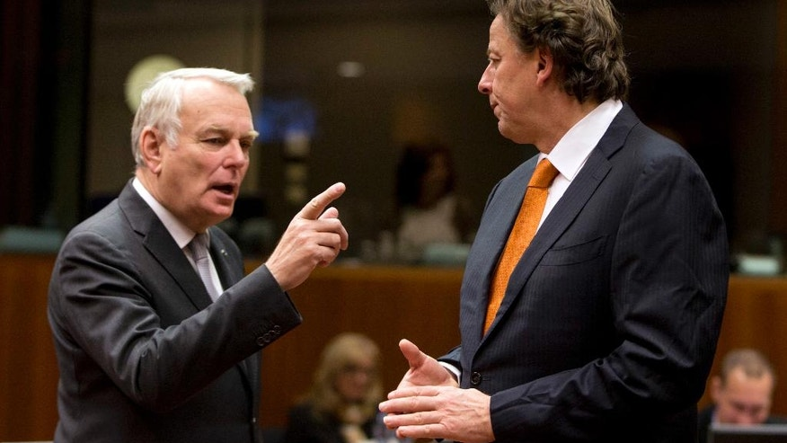 French Foreign Minister Jean-Marc Ayrault, left, speaks with Dutch Foreign Minister Bert Koenders during a round table meeting of EU foreign ministers at the EU Council building in Brussels on Monday, Dec. 12, 2016. EU foreign ministers hold talks Monday on the conflict in Syria, relations with Africa and migration. (AP Photo/Virginia Mayo)