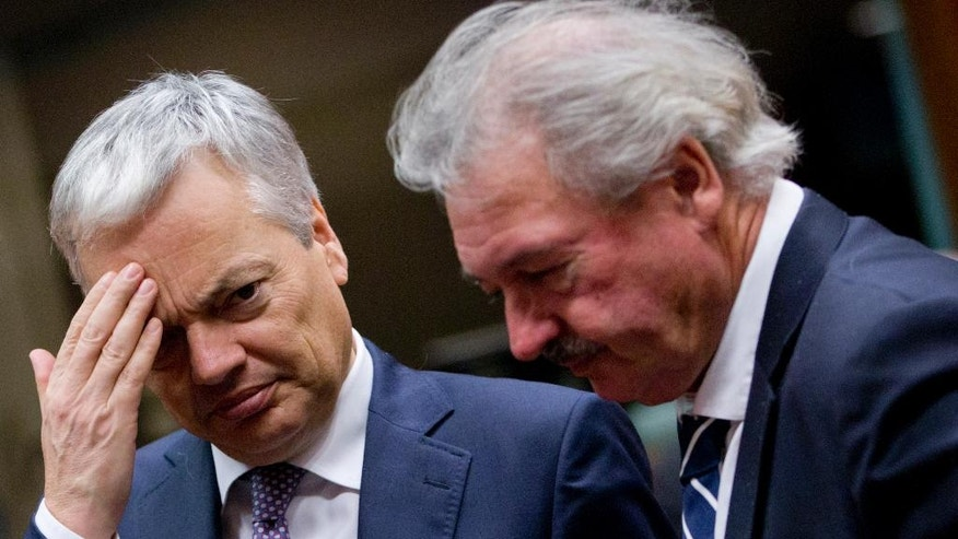Belgian Foreign Minister Didier Reynders, left, speaks with Luxembourg's Foreign Minister Jean Asselborn during a round table meeting of EU foreign ministers at the EU Council building in Brussels on Monday, Dec. 12, 2016. EU foreign ministers hold talks Monday on the conflict in Syria, relations with Africa and migration. (AP Photo/Virginia Mayo)