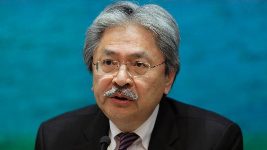 FILE - In this Nov. 4, 2016 file photo, Financial Secretary John Tsang speaks during a press conference at the government headquarters in Hong Kong. Hong Kong's financial chief resigned Monday, Dec. 12, 2016, in what is widely seen as a prelude to a leadership bid for the southern Chinese city's top job.  Tsang tendered his resignation, the government said, in a move that came after the city's deeply unpopular current leader, Chief Executive Leung Chun-ying, announced unexpectedly on Friday that he would not seek a second term in office. (AP Photo/Vincent Yu, File)