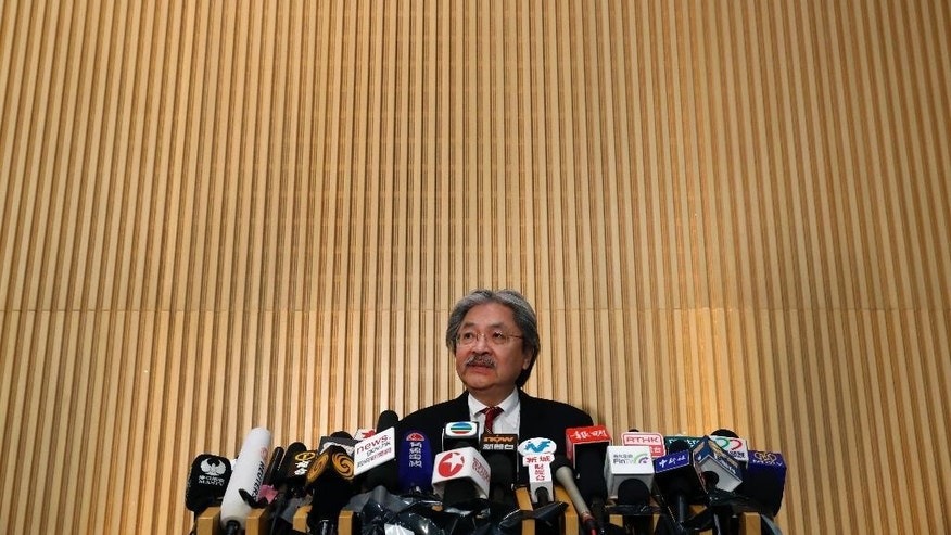 Hong Kong's Financial Secretary John Tsang speaks during a press conference at government headquarters in Hong Kong, Monday, Dec.12, 2016. Tsang resigned on Monday, in what is widely seen as a prelude to a leadership bid for the southern Chinese city's top job. Tsang said he submitted his resignation to the current leader, Chief Executive Leung Chun-ying, who announced unexpectedly on Friday that he would not seek a second term in office. (AP Photo/Vincent Yu)