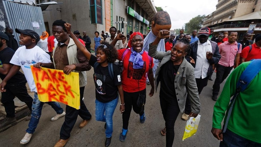 "Protesters march against government corruption, on the 53rd anniversary of Kenya's independence, in downtown Nairobi, Kenya Monday, Dec. 12, 2016. Kenya's president on Monday criticized the International Criminal Court as ""not impartial,"" saying his government ""will give serious thought"" to its membership of the court. (AP Photo/Ben Curtis)"