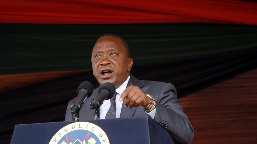 Kenyan President Uhuru Kenyatta delivers his speech to the nation during the 53rd Jamhuri Day Celebrations (Independence Day) at Nyayo Stadium in Nairobi, Monday, Dec. 12, 2016. Kenya got its Independence from British rule in 1963. (AP Photo/Khalil Senosi)