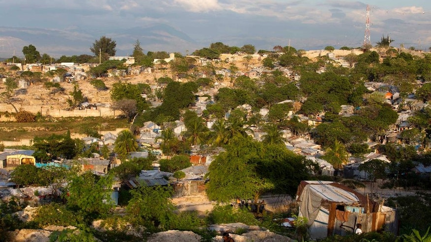This Dec. 5, 2016 photo shows the hillside Delmas tent camp set up nearly seven years ago for people displaced by the 2010 earthquake, in Port-au-Prince, Haiti. The number of people in these makeshift communities has declined since the aftermath, but those who remain are a stubborn reminder that this impoverished country has yet to fully recover. (AP Photo/Dieu Nalio Chery)