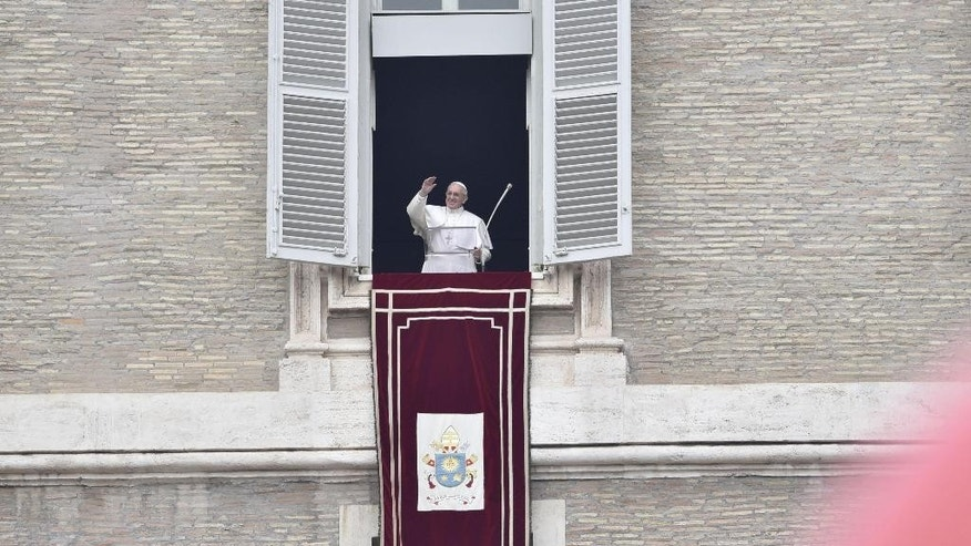Pope Francis blesses faithful, during the Angelus prayer from his studio overlooking St. Peter's Square, at the Vatican, Sunday, Dec. 11, 2016. (Giorgio OnoratiANSA via AP)