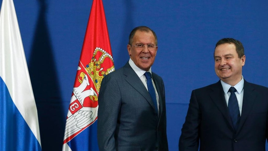 Russian Foreign Minister Sergey Lavrov, smiles during a statement with his Serbian counterpart Ivica Dacic, right, in Belgrade, Serbia, Monday, Dec. 12, 2016. Lavrov is on a two-day official visit to Serbia. (AP Photo/Darko Vojinovic)