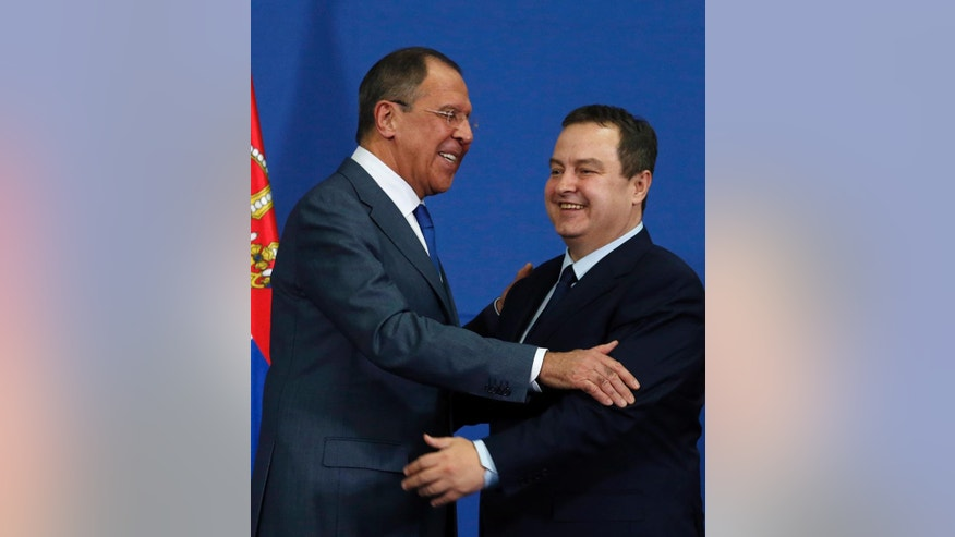 Russian Foreign Minister Sergey Lavrov, left, smiles during during a statement with his Serbian counterpart Ivica Dacic in Belgrade, Serbia, Monday, Dec. 12, 2016. Lavrov is on a two-day official visit to Serbia. (AP Photo/Darko Vojinovic)
