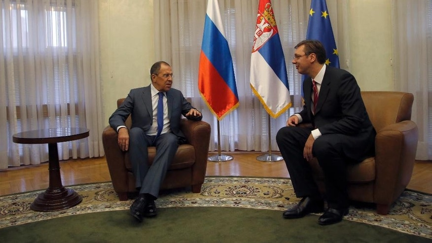 Russian Foreign Minister Sergey Lavrov, left, speaks with Serbian Prime Minister Aleksandar Vucic, in Belgrade, Serbia, Monday, Dec. 12, 2016. Lavrov is on a two-day official visit to Serbia. (AP Photo/Darko Vojinovic)
