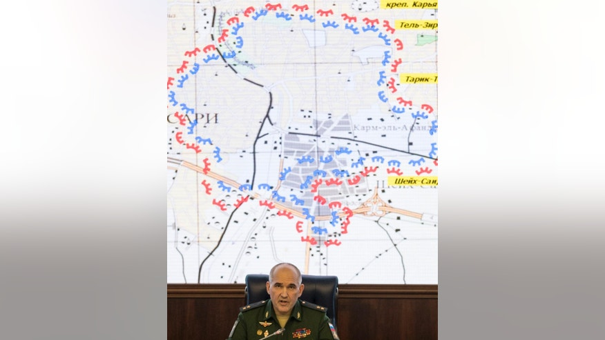 Lt. Gen. Sergei Rudskoi of the Russian military's General Staff speaks at a briefing at the Defense Ministry's headquarters in Moscow, Russia, on Friday, Dec. 9, 2016. Rudskoi said on Friday that 10,500 civilians — including 4,015 children — have left Aleppo's eastern neighborhoods in the last 24 hours. The number could not be independently confirmed. (AP Photo/Pavel Golovkin)