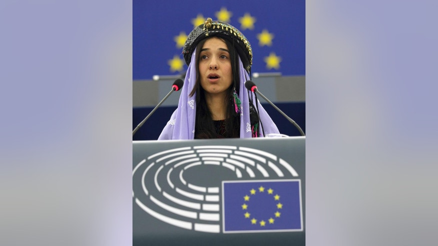 Yazidi woman from Iraq, Nadia Murad Basee, addresses members of the European parliament after receiving the European Union's Sakharov Prize for human rights in Strasbourg, eastern France, Tuesday Dec. 13, 2016. Two Yazidi women who escaped sexual enslavement by the Islamic State group and went on to become advocates for others have won the European Union's Sakharov Prize for human rights. The award, named after Soviet dissident Andrei Sakharov, was created in 1988 to honor individuals or groups who defend human rights and fundamental freedoms. (AP Photo/Christian Lutz)