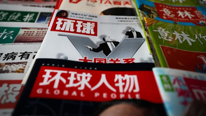 "A copy of a Chinese news magazine fronting a photo of U.S. President-elect Donald Trump and a headline ""Relations of Great Powers"" is displayed for sale at a news stand in Beijing, Tuesday, Dec. 13, 2016. U.S. President-elect Donald Trump's questioning of long-established U.S. policy toward Taiwan is sparking a growing backlash in Beijing and warnings about potentially dangerous disruption in relations between the world's two largest economies. (AP Photo/Andy Wong)"
