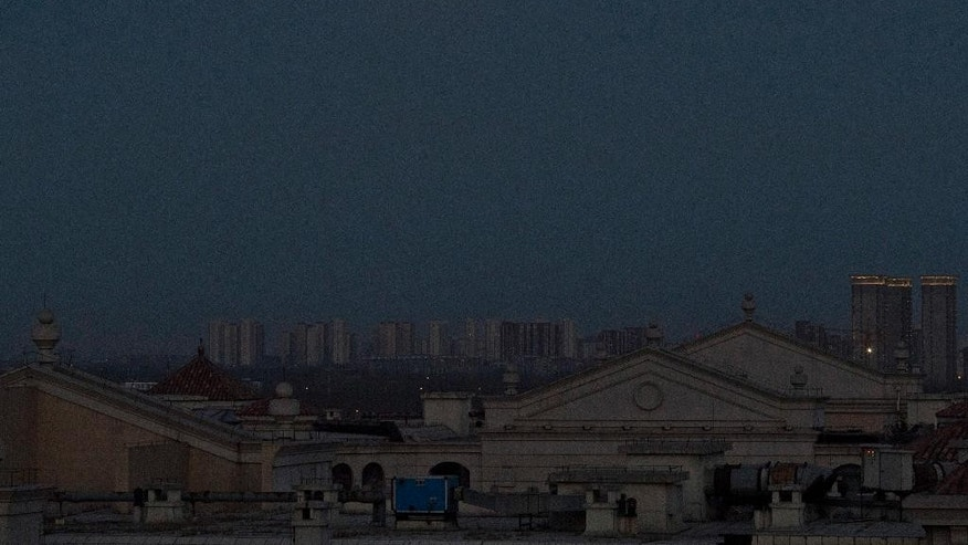 The supermoon rises over Beijing, China, Tuesday, Dec. 13, 2016. The supermoon phenomenon which occurs when the moon reaches a point closer than usual, shone brightly Tuesday night in Beijing, as the smog that often blankets China's capital city and most of the industrial north in winter subsided for the evening. (AP Photo/Ng Han Guan)