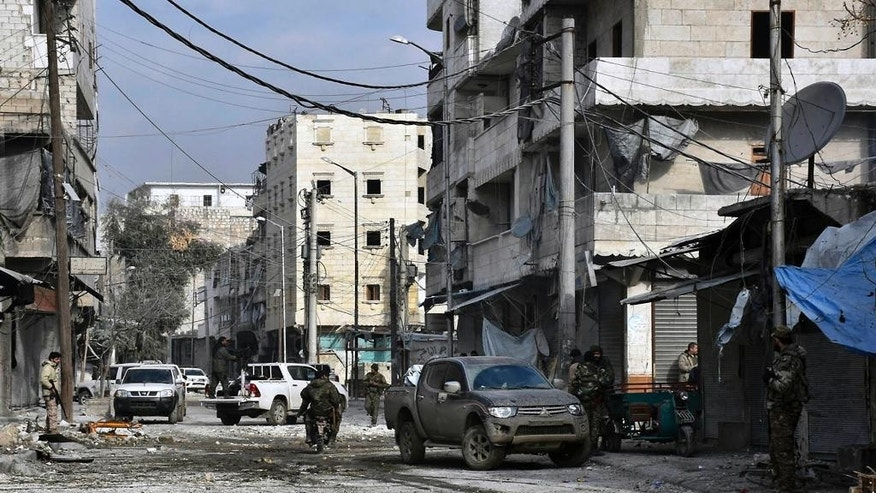 In this photo released by the Syrian official news agency SANA, shows Syrian troops march through the streets of east Aleppo, Syria, Monday, Dec. 12, 2016. Syria's military said Monday it has regained control of 98 percent of eastern Aleppo, as government forces close in the last remaining sliver of a rebel enclave packed with fighters as well as tens of thousands of civilians. (SANA via AP)