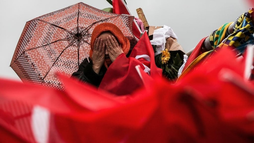 A Turkish woman prays as she visits the Besiktas football club stadium Vodafone Arena in Istanbul, Tuesday, Dec. 13, 2016. Turkey launched a full investigation and started burying the dead Monday after two bombings in Istanbul killed dozens of people and wounded score others near Besiktas' stadium. Turkish authorities have banned distribution of images relating to the Istanbul explosions within Turkey.(AP Photo/Emrah Gurel)