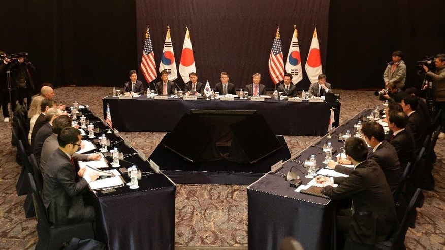 Delegation of South Korea, center, the Unites Stats and Japan, right, attend their trilateral meeting to coordinate strategies on North Korea, in Seoul, South Korea, Tuesday, Dec. 13, 2016. (AP Photo/Ahn Young-joon)