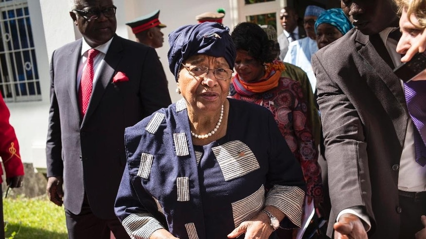 Sierra Leone President, Ernest Bai Koroma, left, and Liberia President, Ellen Johnson Sirleaf, right, on arrival for talks with President Yahya Jammeh, in Banjul, Gambia, Tuesday, Dec. 13, 2016. Several West African leaders have arrived in Gambia to urge the country's leader to respect elections that voted him out of power after 22 years. President Yahya Jammeh initially conceded defeat but late last week announced he was rejecting the Dec. 1 vote results. He alleges voting irregularities. (AP Photo/ Sylvain Cherkaoui)