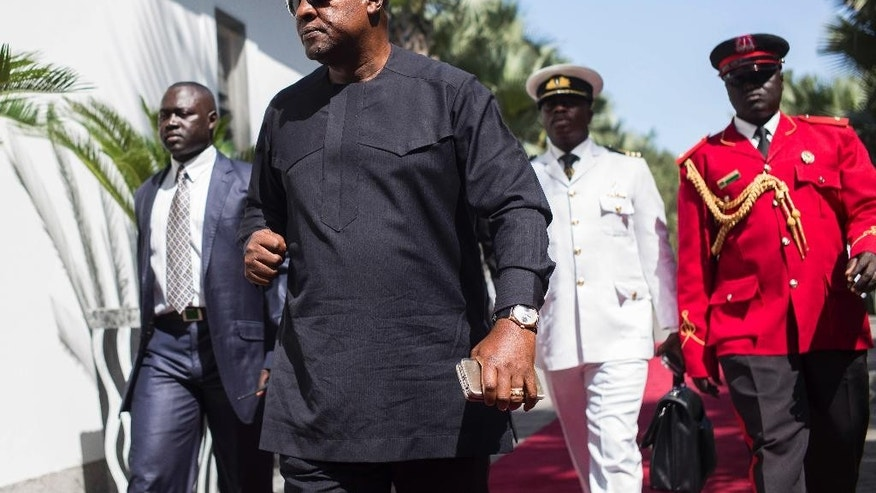 Ghana President, John Dramani Mahama, on arrival for talks with President Yahya Jammeh, in Banjul, Gambia, Tuesday, Dec. 13, 2016. Several West African leaders have arrived in Gambia to urge the country's leader to respect elections that voted him out of power after 22 years. President Yahya Jammeh initially conceded defeat but late last week announced he was rejecting the Dec. 1 vote results. He alleges voting irregularities. (AP Photo/ Sylvain Cherkaoui)