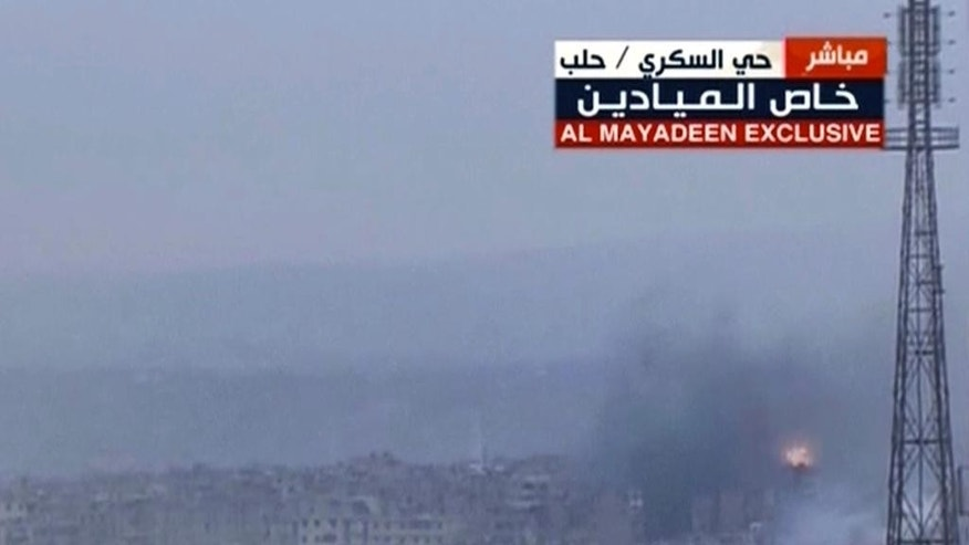 This frame grab from video provided by the Beirut-based pan-Arab satellite channel Al Mayadeen, which is close to the Syrian government, broadcast on Wednesday, Dec. 14, 2016, shows explosions followed by plumes of smoke, in East Aleppo, Syria. A cease-fire deal between rebels and the Syrian government in the city of Aleppo has effectively collapsed with fighter jets resuming their devastating air raids over the opposition's densely crowded enclave in the east of the city. The attacks threaten plans to evacuate the rebels and tens of thousands of civilians out of harm's way, in what would seal the opposition's surrender of the city. (Al Mayadeen TV, via AP)