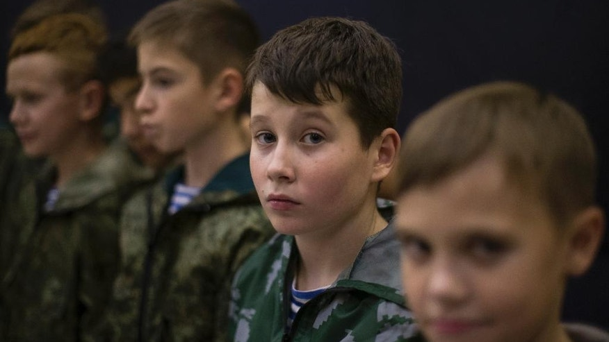 In this photo taken on Friday, Oct. 28, 2016, Russian children listen to a trainer in parachute techniques in Verkhnyaya Pyshma, just outside Yekaterinburg, Russia. The training has been run by Yunarmia (Young Army), an organization sponsored by the Russian military that aims to encourage patriotism among the Russian youth. (AP Photo/Alexander Zemlianichenko)