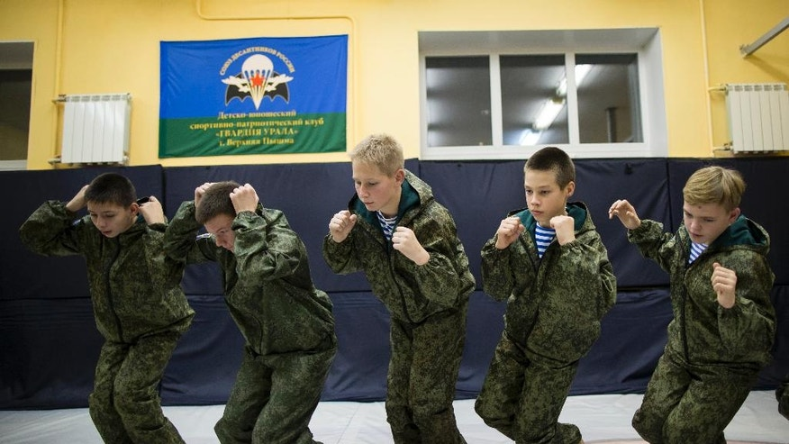 In this photo taken on Friday, Oct. 28, 2016, Russian children attend a training in parachute techniques in Verkhnyaya Pyshma, just outside Yekaterinburg, Russia. The training has been run by Yunarmia (Young Army), an organization sponsored by the Russian military that aims to encourage patriotism among the Russian youth. (AP Photo/Alexander Zemlianichenko)