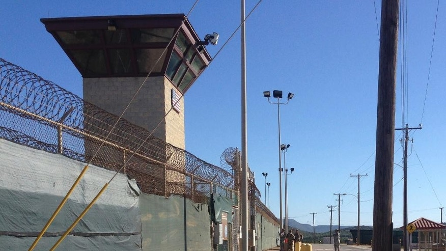 This Dec. 10, 2016 photo shows the exterior of Camp 6 at the detention center at the Guantanamo Bay U.S. Naval base, in Cuba, where the U.S. holds 59 prisoners, including 22 cleared for release. The military has consolidated all remaining prisoners in Camp 6 and Camp 7, leaving other parts of the detention center vacant. (AP Photo/Ben Fox)