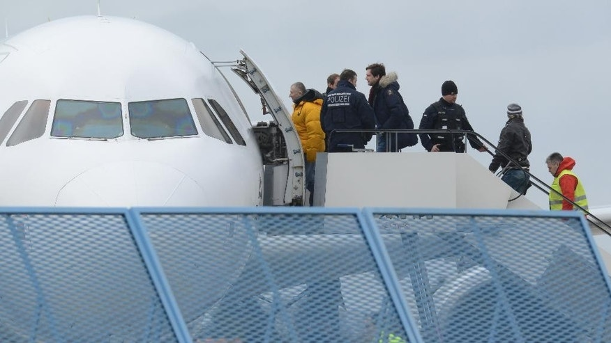 FILE - In this Feb. 2, 2015 file photo migrants who were refused asylum in Germany enter a plane In Rheinmuenster, Germany. A German pro-refugee group says that some 50 Afghans are to be deported to their homeland after being rejected as asylum seekers in Germany. Pro Asyl said that the group of Afghans would be deported on Wednesday night from Frankfurt airport. (Patrick Seeger/dpa via AP, file)