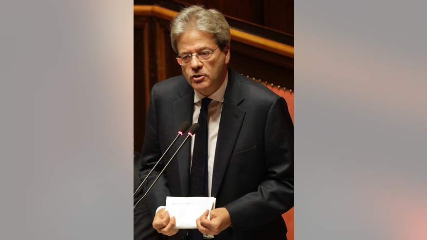 Italian Premier Paolo Gentiloni speaks ahead of a confidence vote for his government at the Senate, in Rome, Wednesday, Dec. 14, 2016. On Tuesday his government won a vote of confidence at the Lower Chamber, approval from both houses is required for the government to carry on its mandate. (AP Photo/Gregorio Borgia)