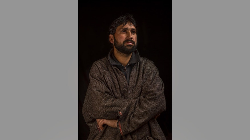 "In this Nov. 29, 2016 photo, Abbas Ahmad Pandit poses for a portrait in the village of Karimabad, Indian-controlled Kashmir.  Pandit's right eye got severely damaged by pellet injuries during clashes with Indian security forces. Indian authorities began using shotguns for crowd control in Indian-controlled Kashmir in 2010, calling them ""non-lethal"" weapons that could control massive crowds of stone-throwing protests. (AP Photo/Bernat Armangue)"