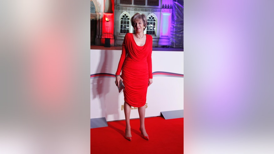 Britain's Prime Minister Theresa May poses for photographers upon arrival at The Sun Military Awards 2016 in London, Wednesday, Dec. 14, 2016. (Photo by Joel Ryan/Invision/AP)
