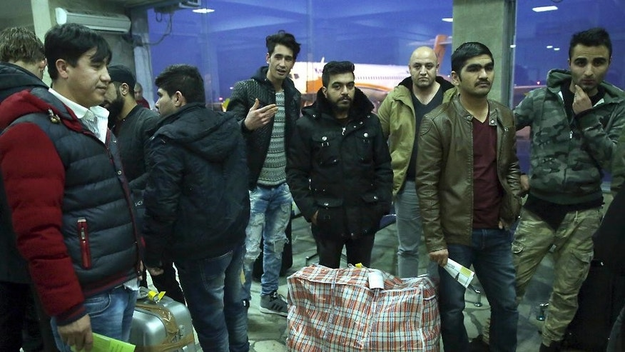 Afghans who were deported from Germany arrive at Kabul International Airport, Kabul, Afghanistan, Thursday, Dec. 15, 2016. A Kabul airport official says 34 Afghan asylum seekers returned home after being deported from Germany the previous day. (AP Photos/Massoud Hossaini)