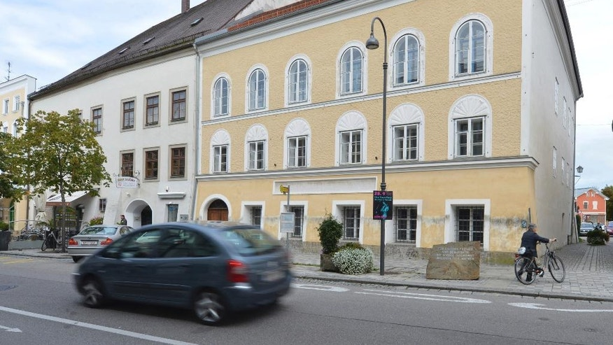 FILE - This Sept. 27, 2012 file picture shows an exterior view of Adolf Hitler's birth house, front, in Braunau am Inn, Austria. Austrian government officials have decided Thursday, Dec. 15, 2016, against tearing down the house where Hitler was born and said it will instead be redesigned and used to house a charitable organization. (AP Photo / Kerstin Joensson, file)