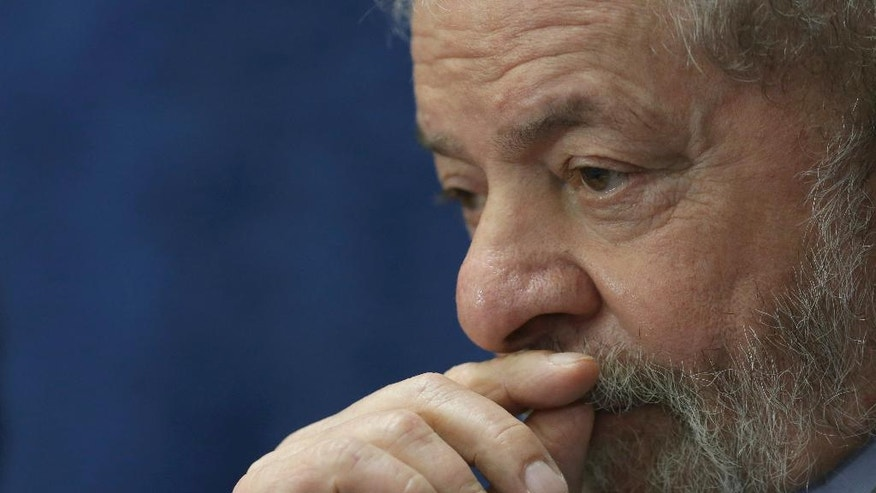 FILE - In this Aug. 29, 2016 file photo, Brazil's former President Luiz Inacio Lula da Silva attends the impeachment trial of Brazil's suspended President Dilma Rousseff, in Brasilia, Brazil. On Friday, Dec. 9, 2016, prosecutors charged the former leader and his son with corruption in a case involving the purchase of 36 Swedish fighter jets by the South American nation. (AP Photo/Eraldo Peres, File)