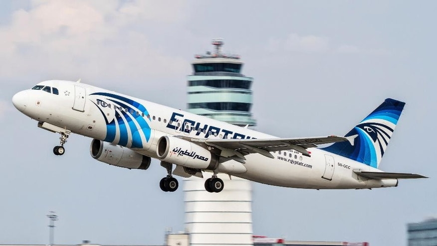 FILE -- This August 21, 2015 file photo shows an EgyptAir Airbus A320 with the registration SU-GCC taking off from Vienna International Airport, Austria. The plane crashed in the Mediterranean Sea in May, 2016, killing all 66 passengers and crew on board. Egypt's Civil Aviation Ministry said Thursday, Dec. 15, 2016, that traces of explosives have been found on some of the victims of the  flight. A ministry statement said a criminal investigation will now begin into the crash of Flight 804. No one has claimed to have attacked the plane. (AP Photo/Thomas Ranner, File)